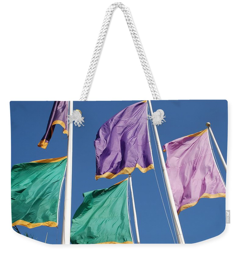 Flags Weekender Tote Bag featuring the photograph Flags by Rob Hans