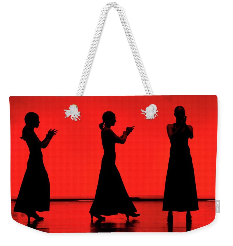 Red Weekender Tote Bag featuring the photograph Flamenco Red An Black Spanish Passion For Dance And Rithm by Pedro Cardona Llambias