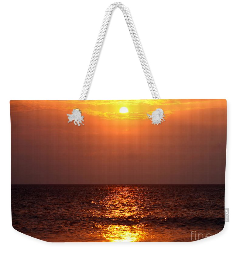 Sunrise Weekender Tote Bag featuring the photograph Flaming Sunrise by Nadine Rippelmeyer