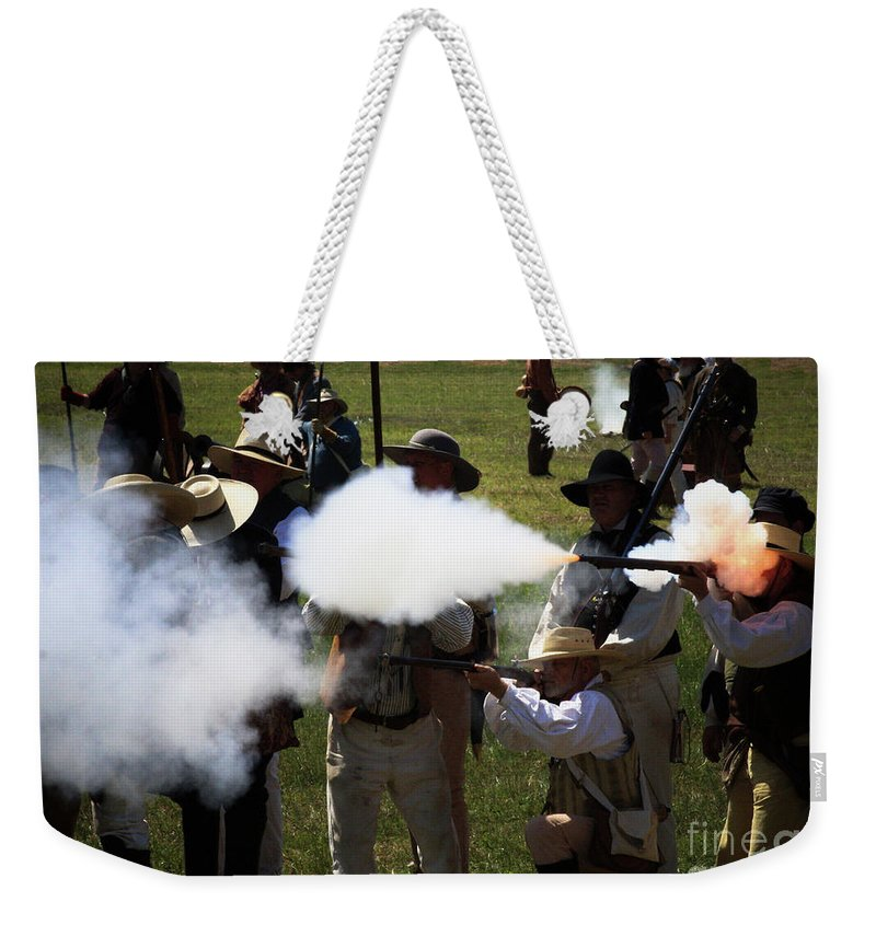 Re-enactment Weekender Tote Bag featuring the photograph Flash Fire by Kim Henderson