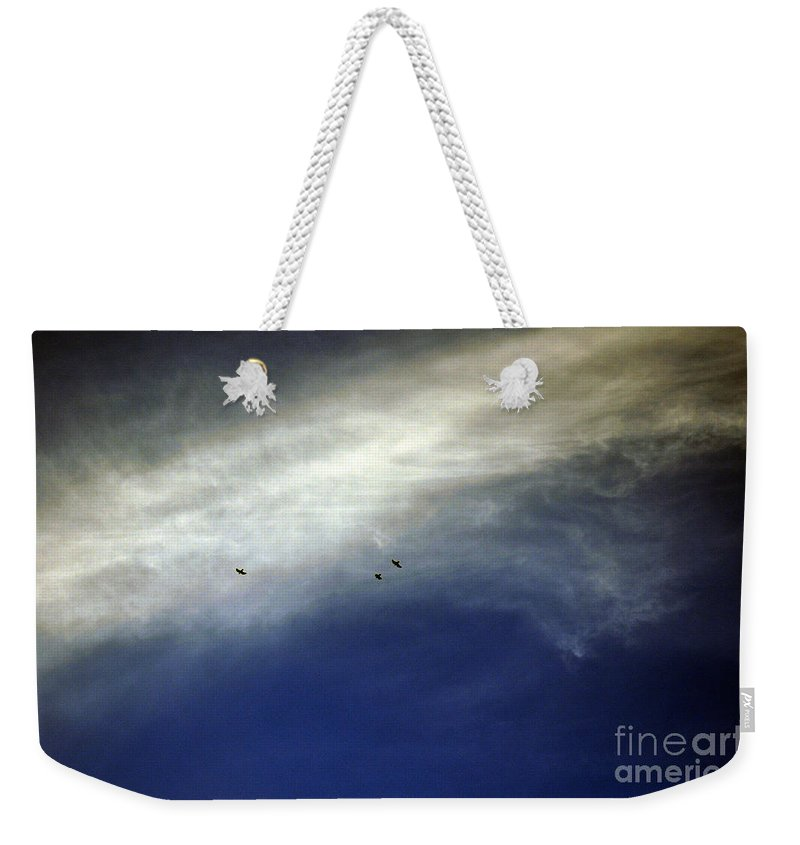 Clay Weekender Tote Bag featuring the photograph Flight by Clayton Bruster