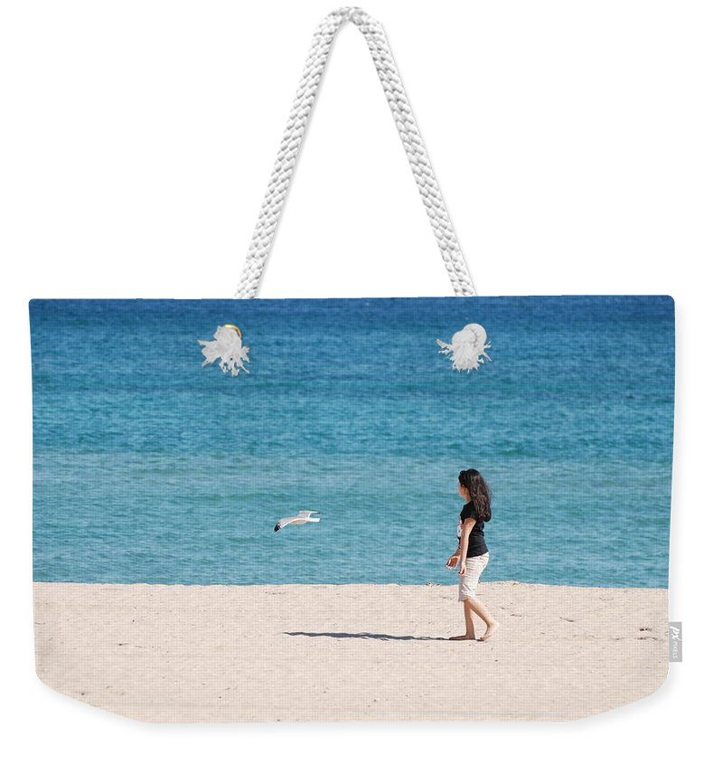 Ocean Weekender Tote Bag featuring the photograph Flight Of The Angel by Rob Hans