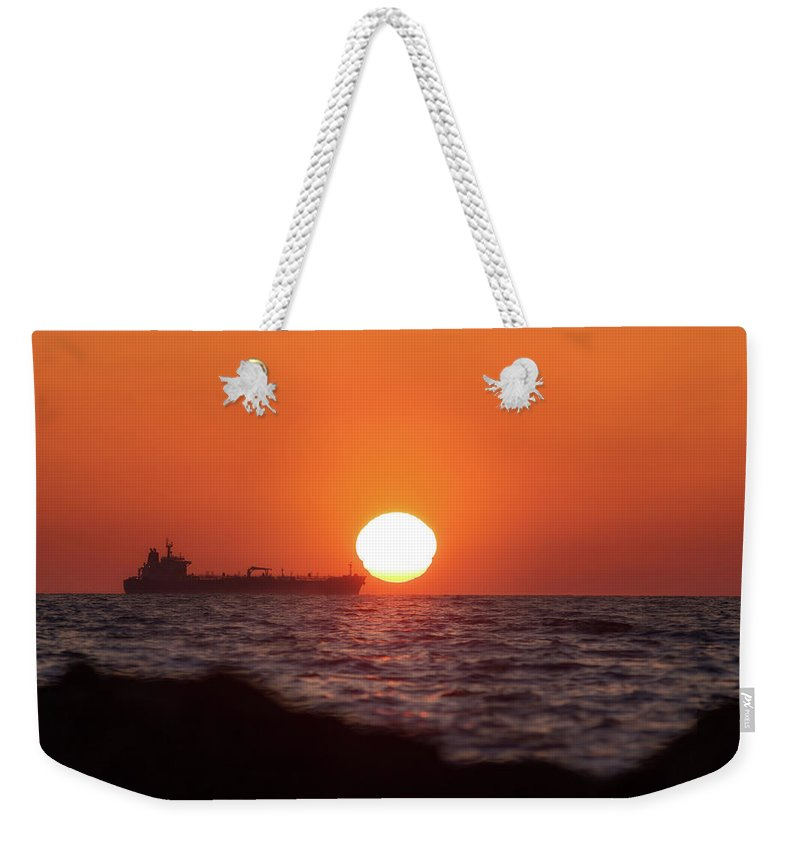 Sun Weekender Tote Bag featuring the photograph Floating Around The Sun by Matteo Viviani
