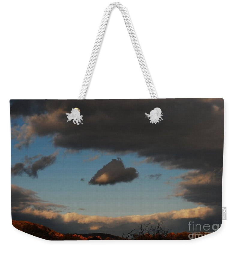Heart Weekender Tote Bag featuring the photograph Floating Heart by Lori Tambakis