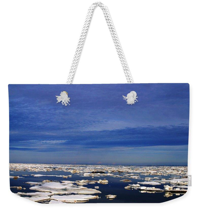 Alaska Weekender Tote Bag featuring the digital art Floating Ice by Anthony Jones