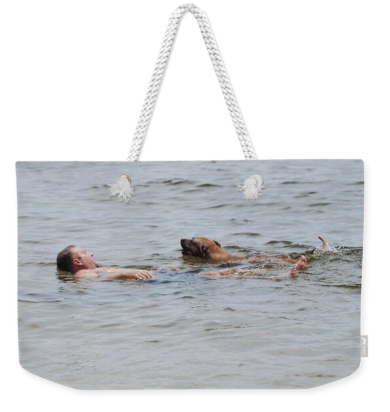 Man Weekender Tote Bag featuring the photograph Floating In The Sea by Rob Hans