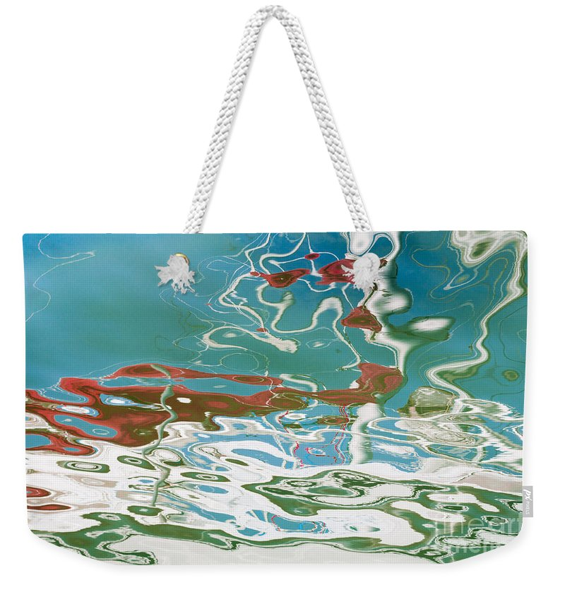 Floating Weekender Tote Bag featuring the photograph Floating On Blue 35 by Wendy Wilton
