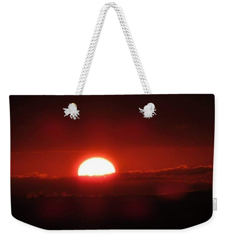 Coastal Shoreline Weekender Tote Bag featuring the photograph Floating Sunrise by Christy Witschie