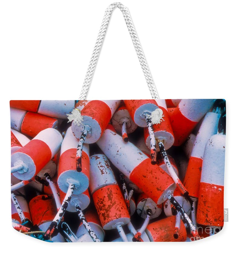 Floats Weekender Tote Bag featuring the photograph Floats by Thomas Marchessault