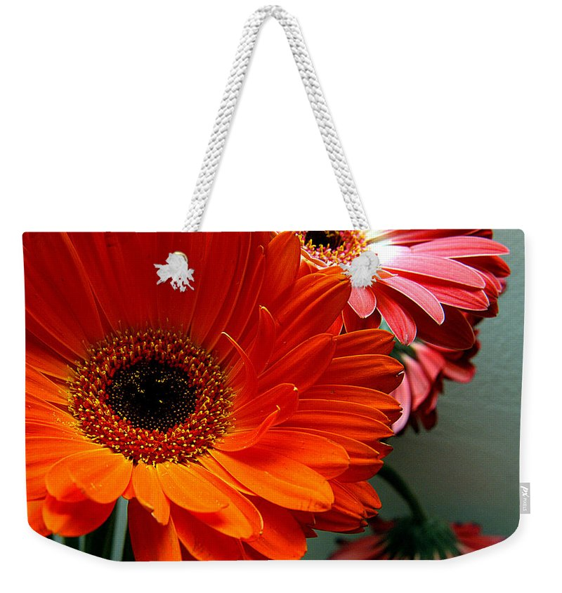 Clay Weekender Tote Bag featuring the photograph Floral Art by Clayton Bruster