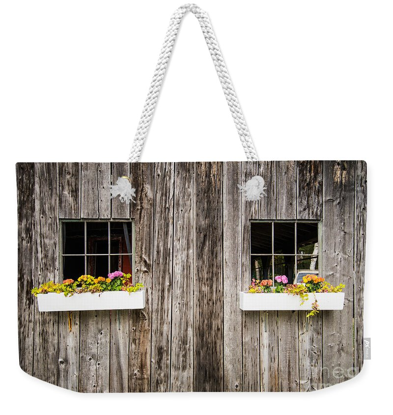 Floral Weekender Tote Bag featuring the photograph Floral Barn Planters by Glenn Gordon