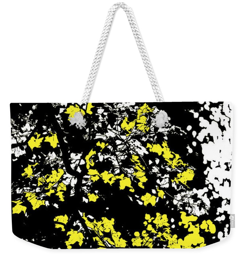 Motif Weekender Tote Bag featuring the photograph Floral Surprise by Pierre Logwin