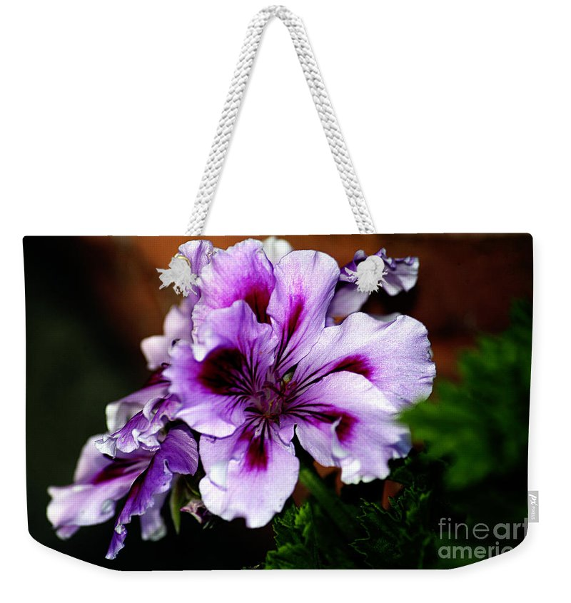 Clay Weekender Tote Bag featuring the photograph Florals by Clayton Bruster
