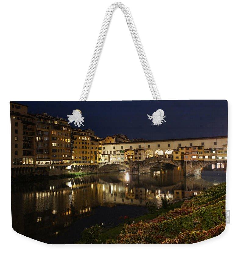 Georgia Mizuleva Weekender Tote Bag featuring the photograph Florence Italy Night Magic - A Glamorous Evening At Ponte Vecchio by Georgia Mizuleva