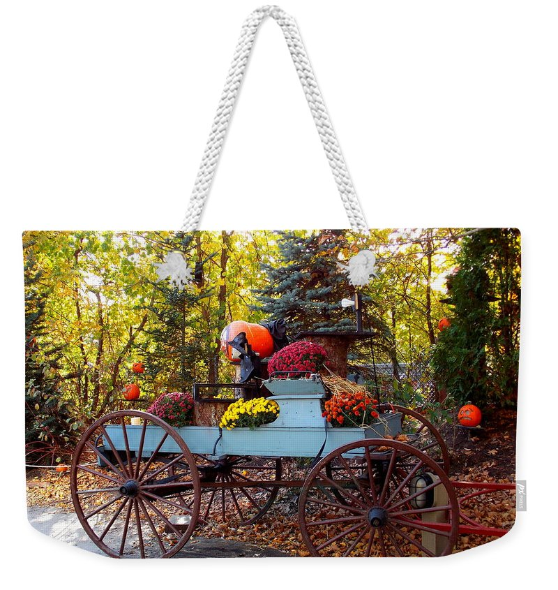 Roger Williams Park Weekender Tote Bag featuring the photograph Flower Filled Wagon by Catherine Gagne