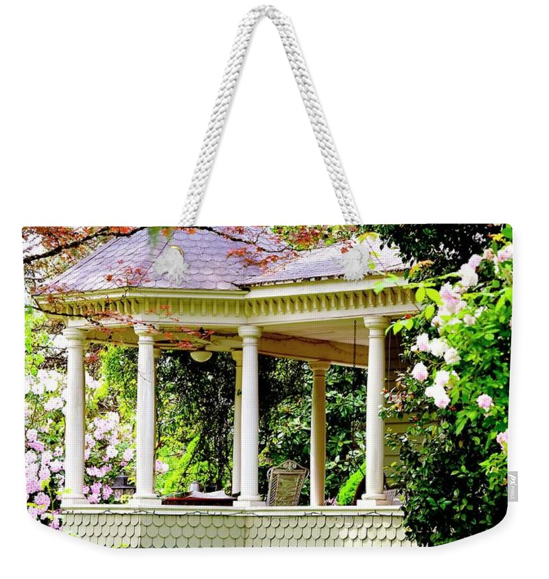 First Weekender Tote Bag featuring the photograph Flower Garden Chair by Jerry Sodorff
