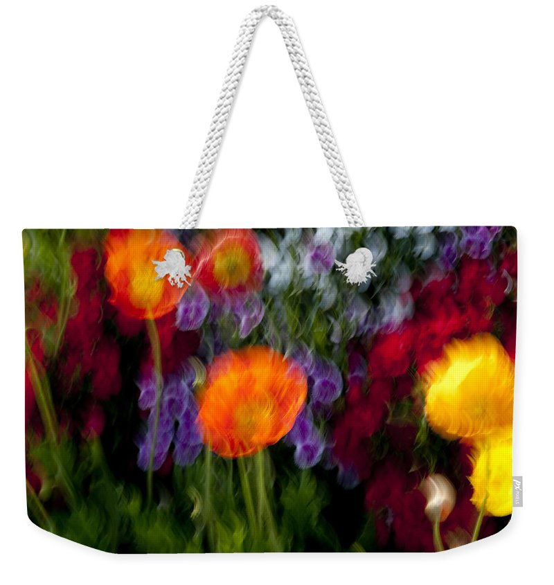 Flowers Weekender Tote Bag featuring the photograph Flower Motion by Kelley King