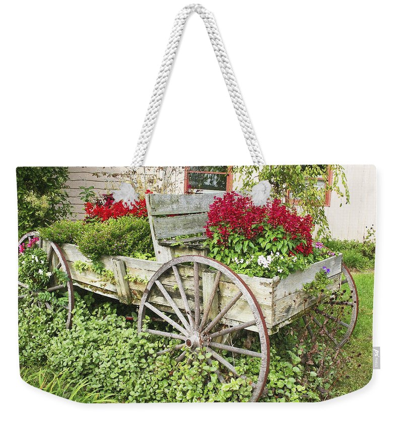 Wagon Weekender Tote Bag featuring the photograph Flower Wagon by Margie Wildblood