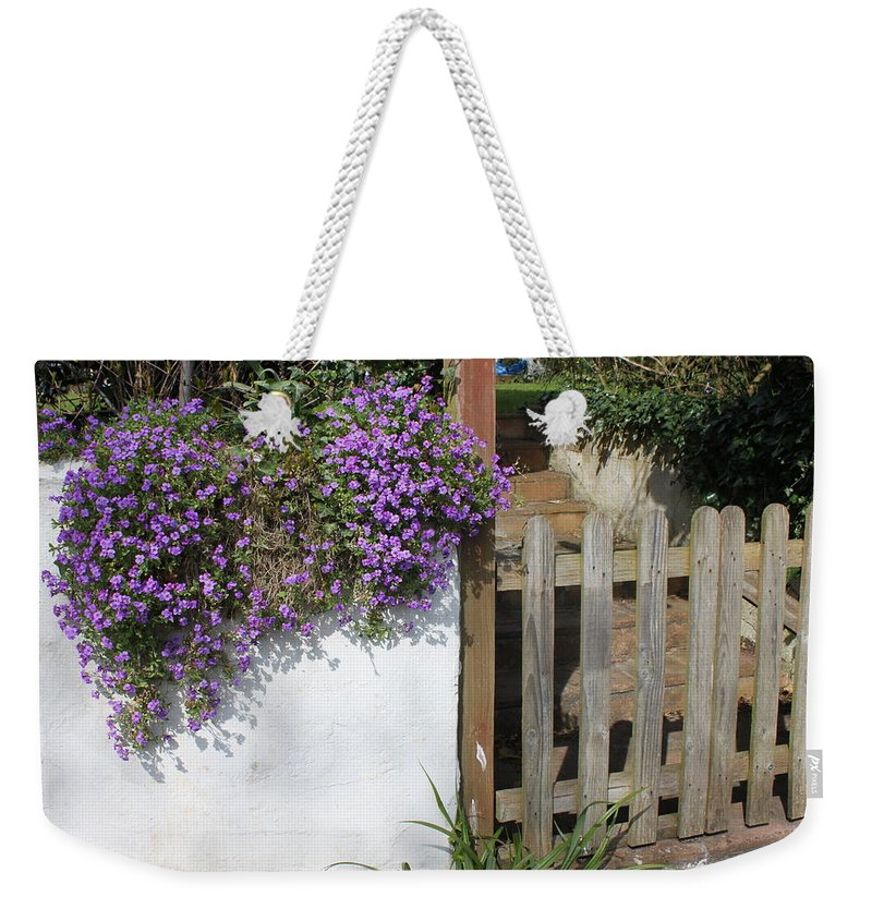 Flowers Weekender Tote Bag featuring the photograph Flower Wall by Lauri Novak