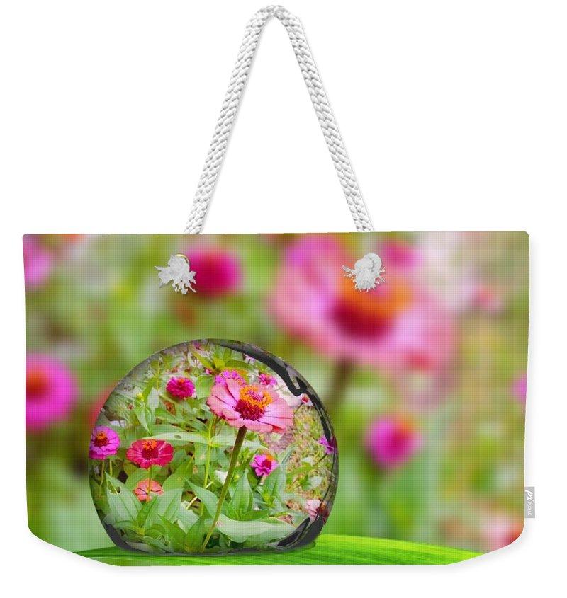 Flower In Water Drop Weekender Tote Bag featuring the photograph Flowerdrop by Debra White