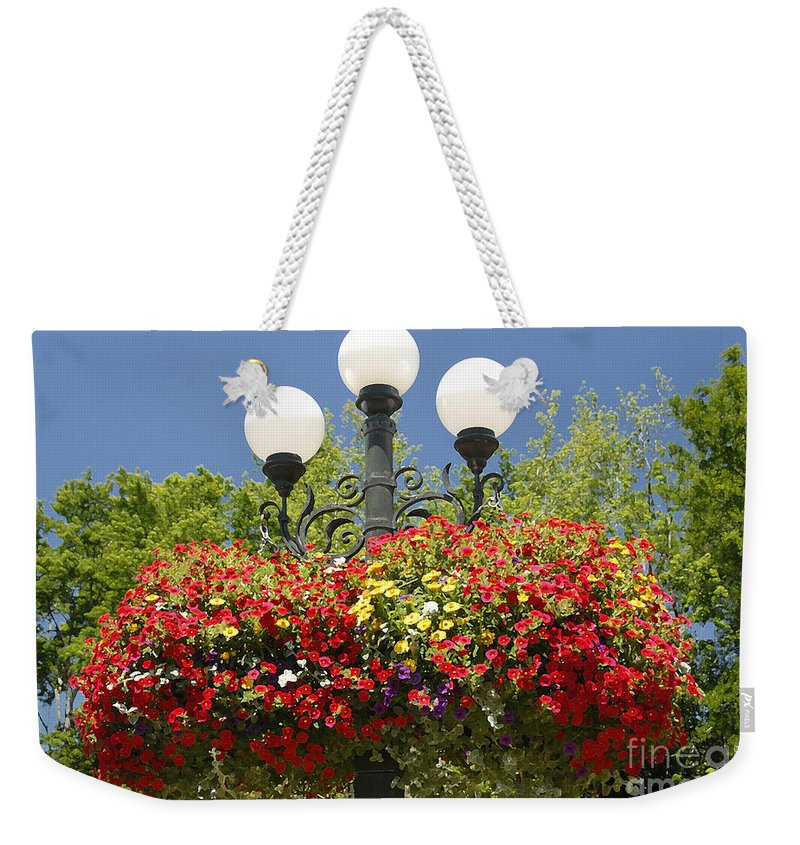 Flowers Weekender Tote Bag featuring the photograph Flowered Lamppost by David Lee Thompson