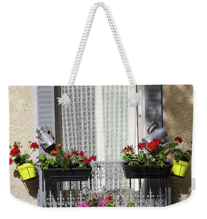 Window Weekender Tote Bag featuring the photograph Flowered Window by Paul MAURICE