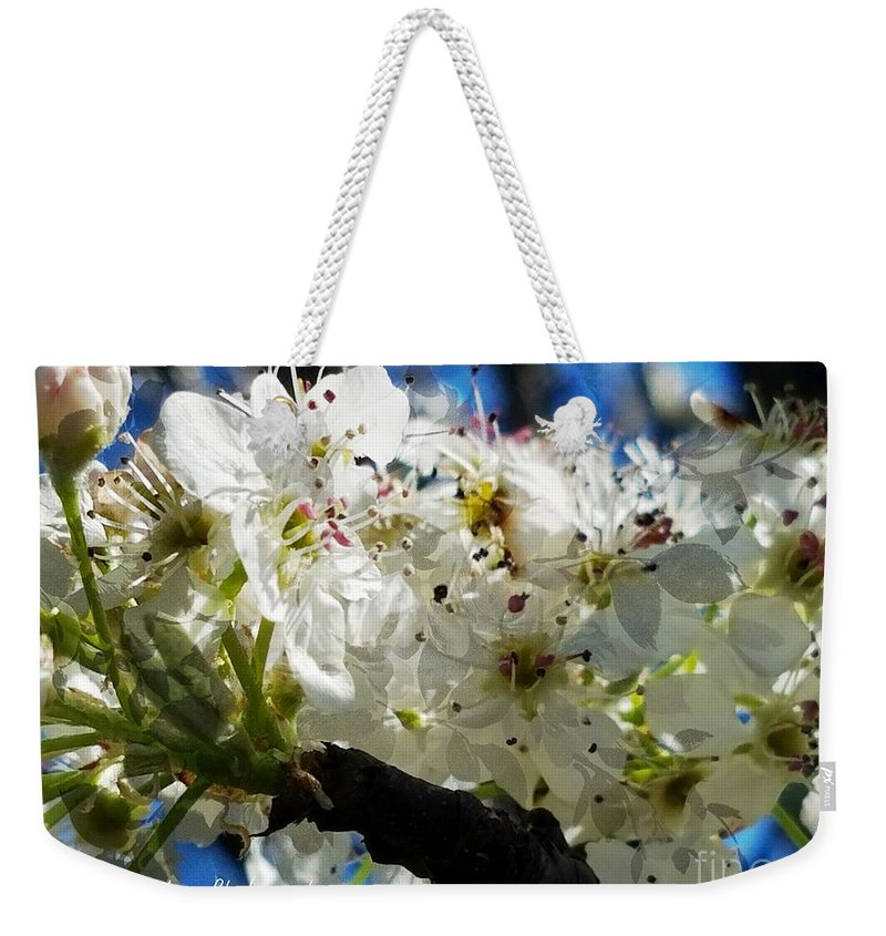 Flowering Pear Weekender Tote Bag featuring the photograph Flowering Pear by Maria Urso