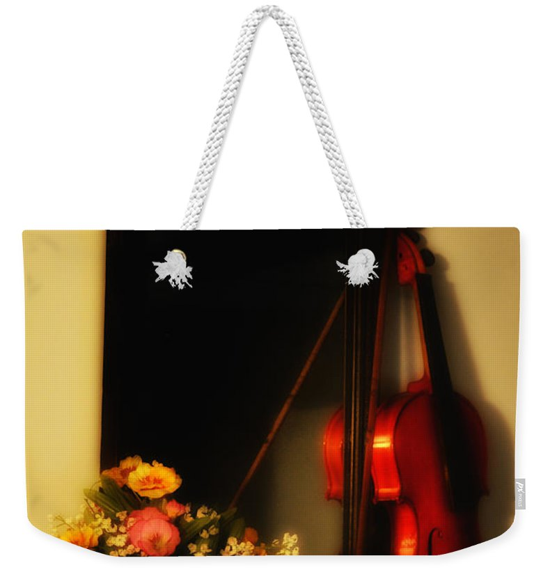 Flowers Weekender Tote Bag featuring the photograph Flowers And Violin by Bill Cannon