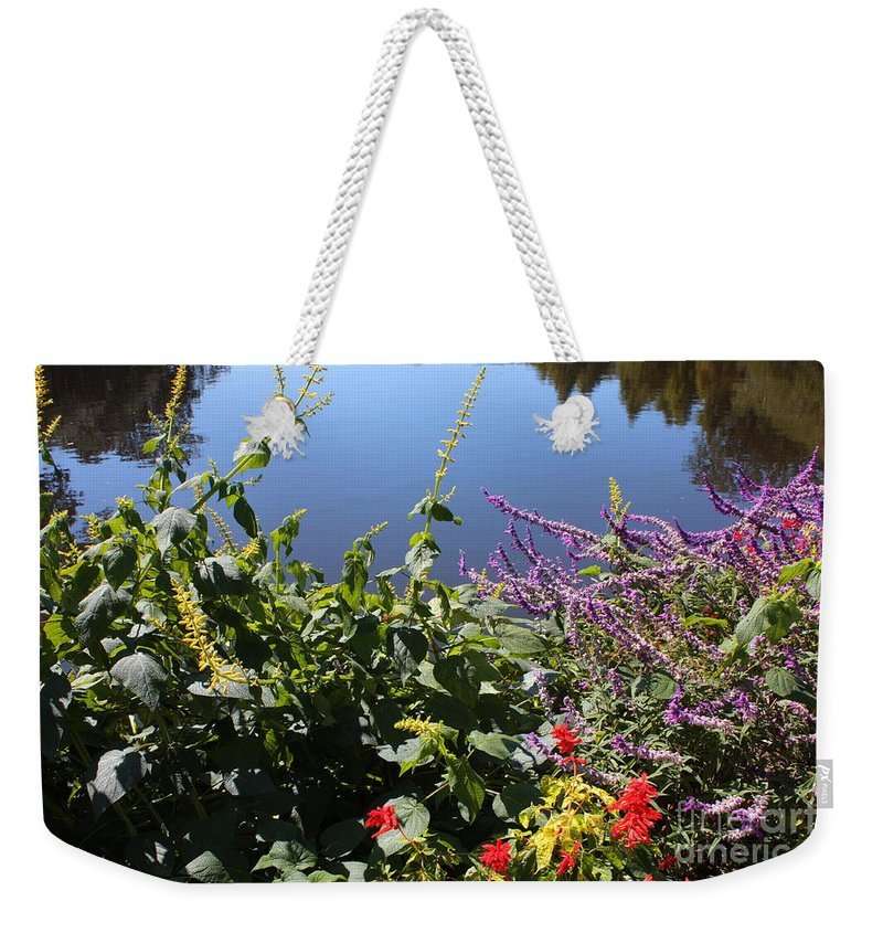 Pond Weekender Tote Bag featuring the photograph Flowers By The Pond by Carol Groenen