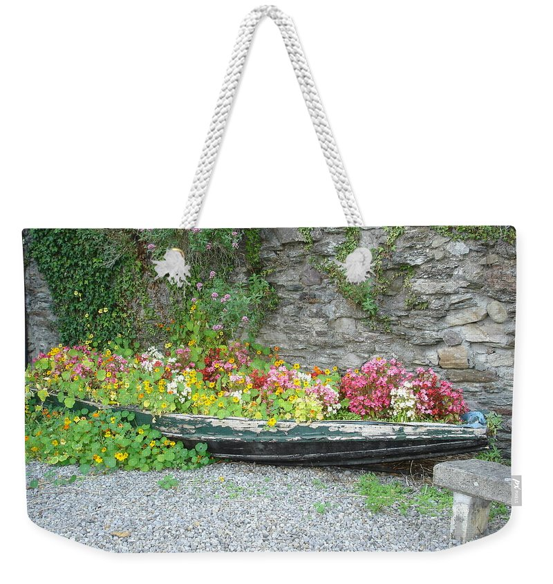 Inistioge Weekender Tote Bag featuring the photograph Flowers Floating by Kelly Mezzapelle