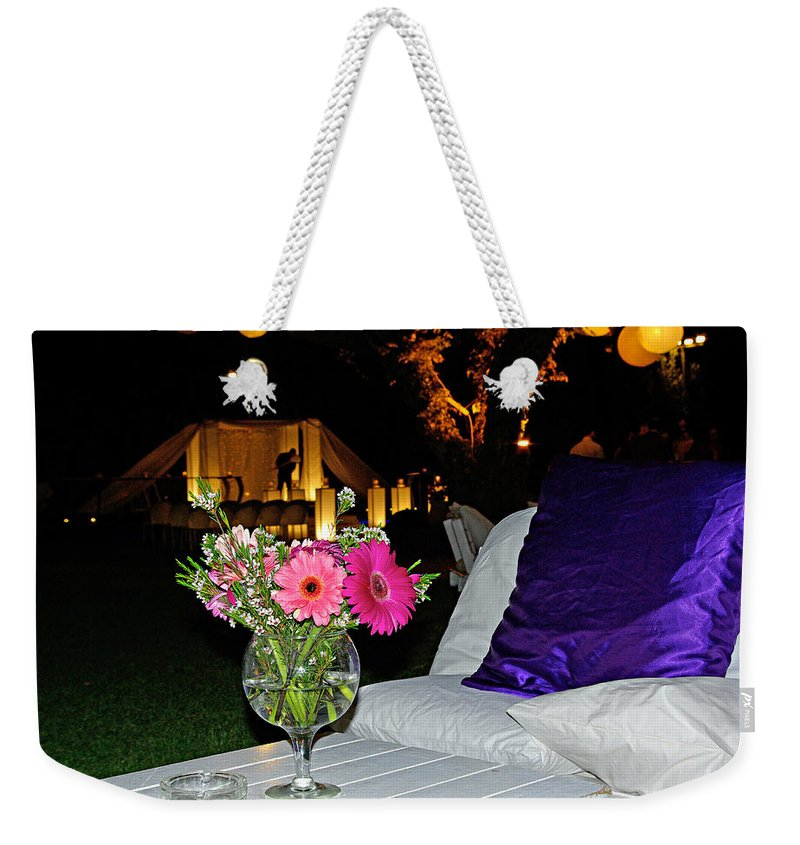 Flowers Weekender Tote Bag featuring the photograph Flowers In A Vase On A White Table by Zal Latzkovich