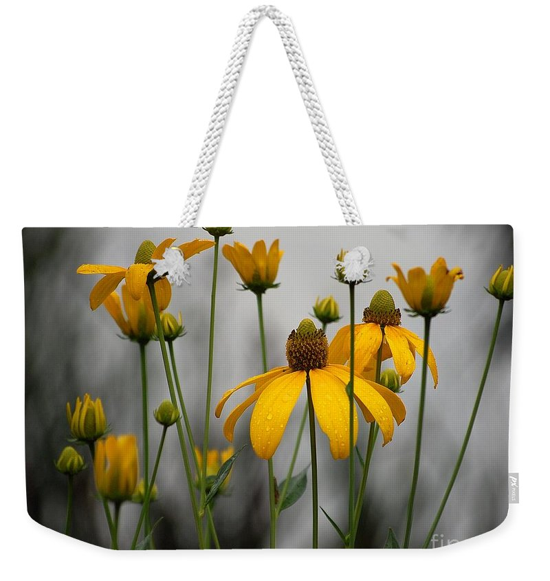 Flowers In The Rain Weekender Tote Bag featuring the photograph Flowers in the rain by Robert Meanor