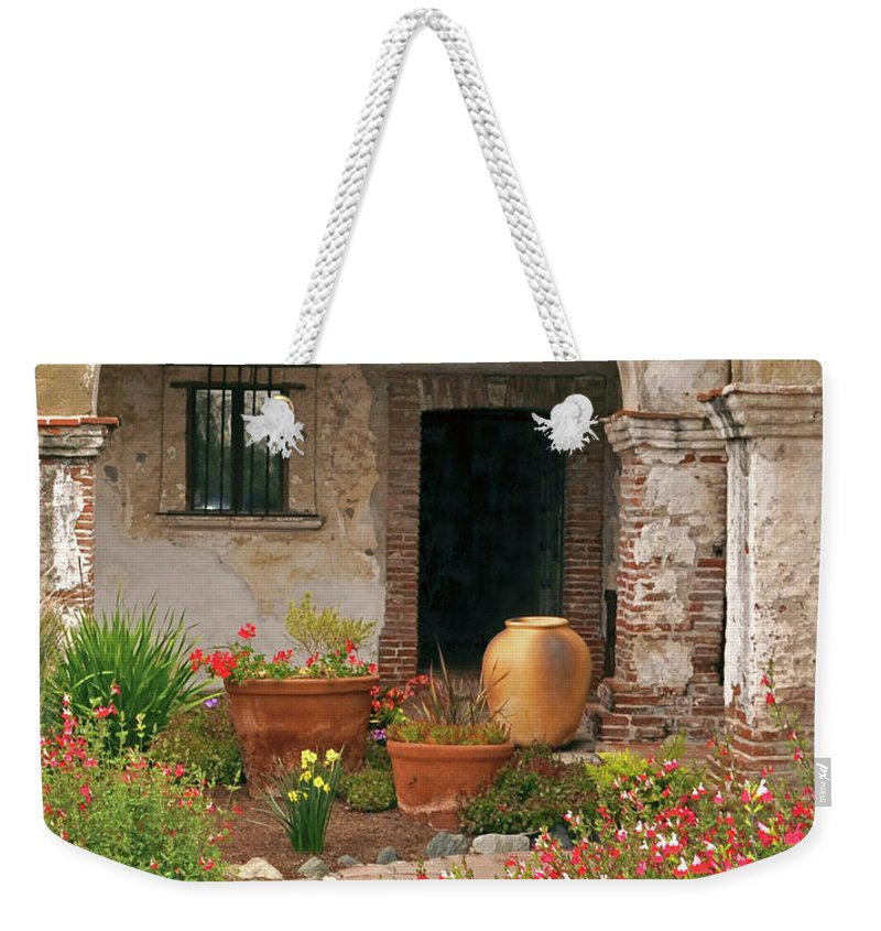 California Missions Weekender Tote Bag featuring the photograph Flowers In The South Wing, Mission San Juan Capistrano, California by Denise Strahm