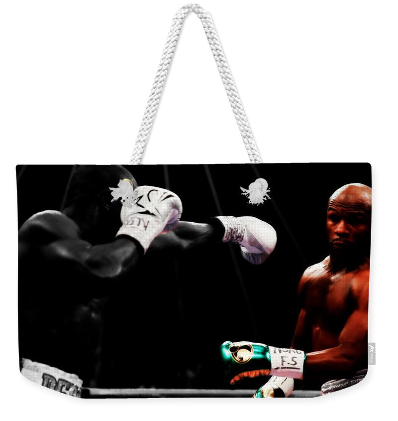 Mayweather Weekender Tote Bag featuring the mixed media Floyd Mayweather Making Them Miss by Brian Reaves