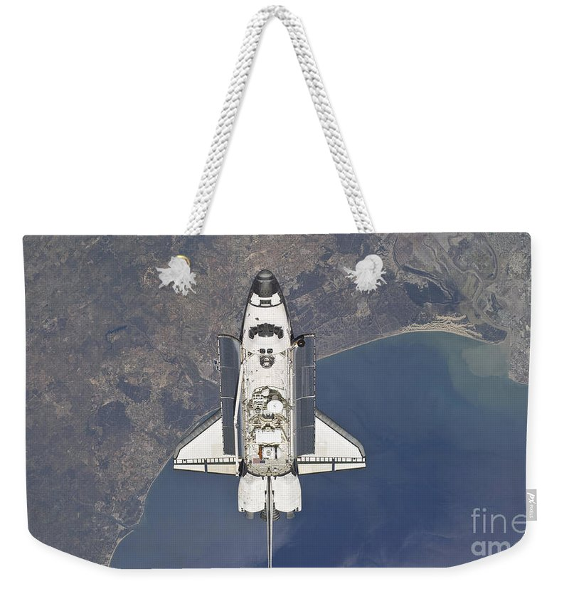 Sts-132 Weekender Tote Bag featuring the photograph Flying Above The Atlantic Coast by Stocktrek Images