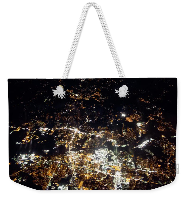 Flying Weekender Tote Bag featuring the photograph Flying At Night Over Cities Below by Alex Grichenko