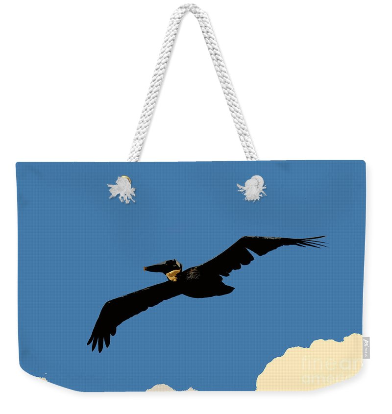 Pelican Weekender Tote Bag featuring the photograph Flying Pelican by David Lee Thompson