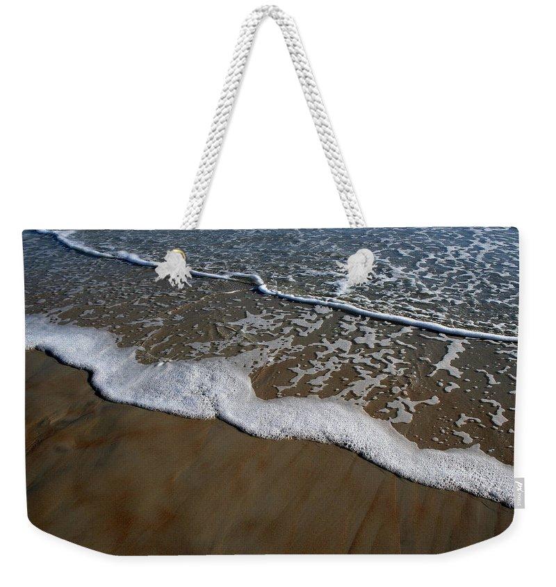 Beach Sand Wave Waves Foam Foamy White Sunny Clear Water Ocean Weekender Tote Bag featuring the photograph Foamy Water by Andrei Shliakhau