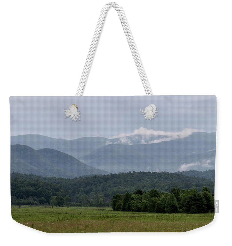 Adventure Weekender Tote Bag featuring the photograph Fog Forming In The Mountains by Benjamin King