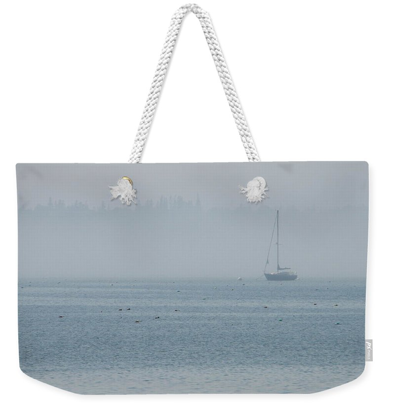 Fog Weekender Tote Bag featuring the photograph Fog On Davis Cove by Kelly Mezzapelle