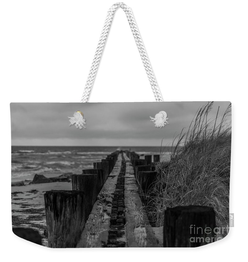 Folly Beach Weekender Tote Bag featuring the photograph Folly Beach Anti Erosion Pier by Dale Powell