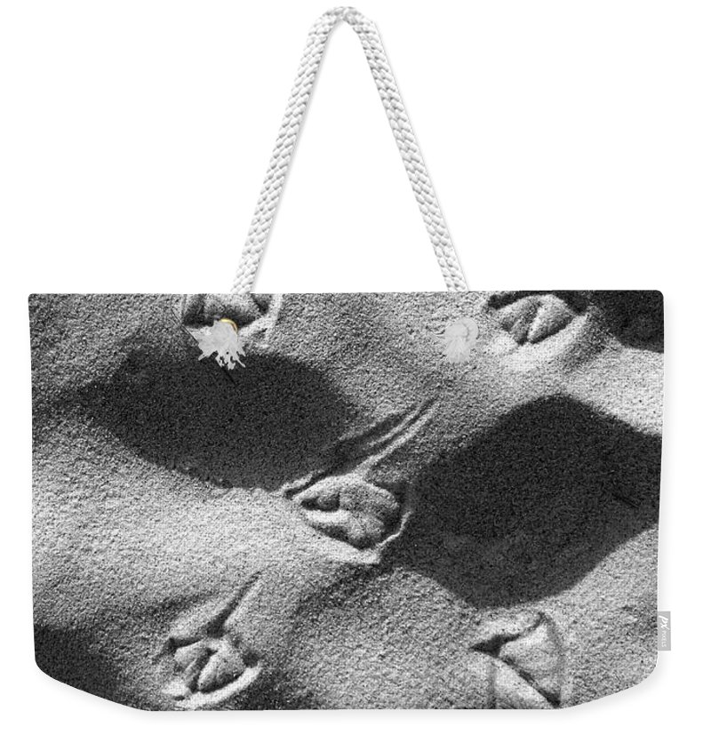 Footprints Weekender Tote Bag featuring the photograph Footprints by Charles Harden