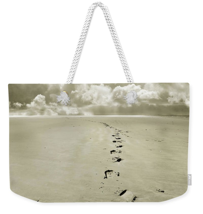 Footprints Weekender Tote Bag featuring the photograph Footprints In Sand by Mal Bray