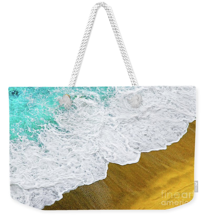 Water Weekender Tote Bag featuring the photograph Footsteps In The Sand Hopelessly Facing The Rising Tide by Silvia Ganora