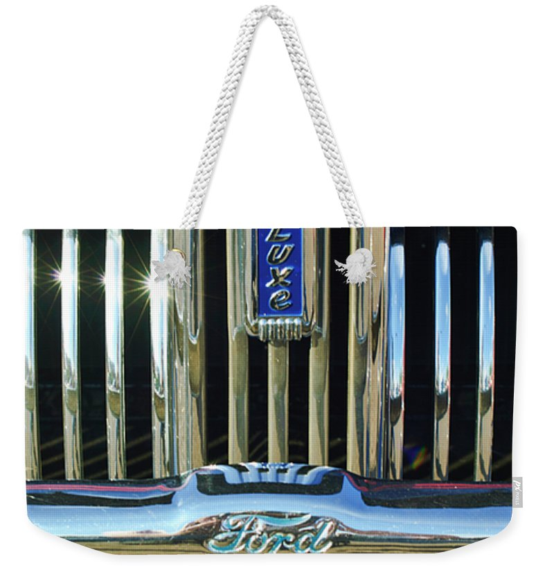 Ford Deluxe Weekender Tote Bag featuring the photograph Ford Deluxe Grille by Jill Reger