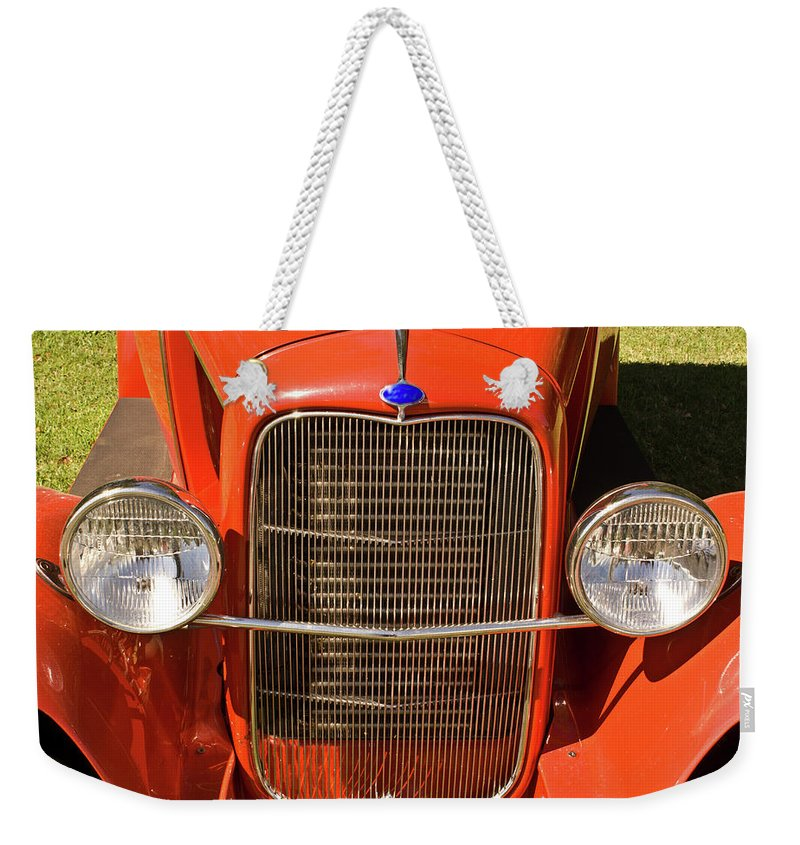 Ford Weekender Tote Bag featuring the photograph Antique Car Headlights by Douglas Barnett