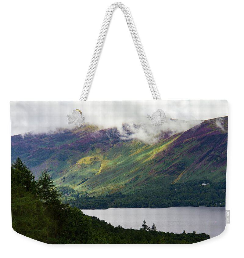 Cumbria Lake District Weekender Tote Bag featuring the photograph Forest And Lake Derwent Water Drama by Iordanis Pallikaras