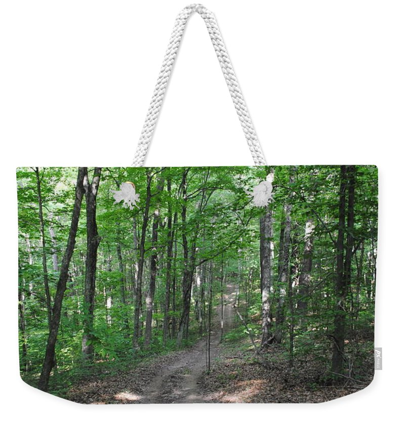 Forest Weekender Tote Bag featuring the photograph Forest Road by Jost Houk