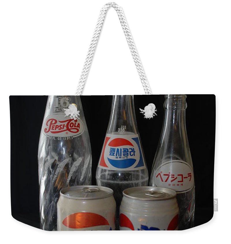 Arabic Weekender Tote Bag featuring the photograph Foriegn Colas by Rob Hans