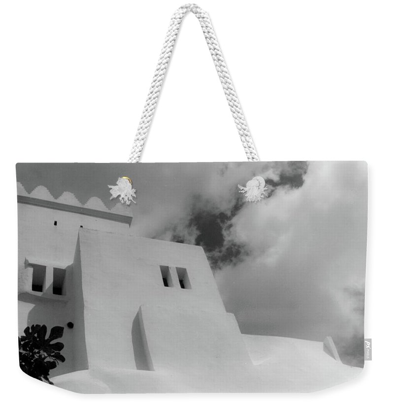 Weekender Tote Bag featuring the photograph Fortress by Mark Alesse